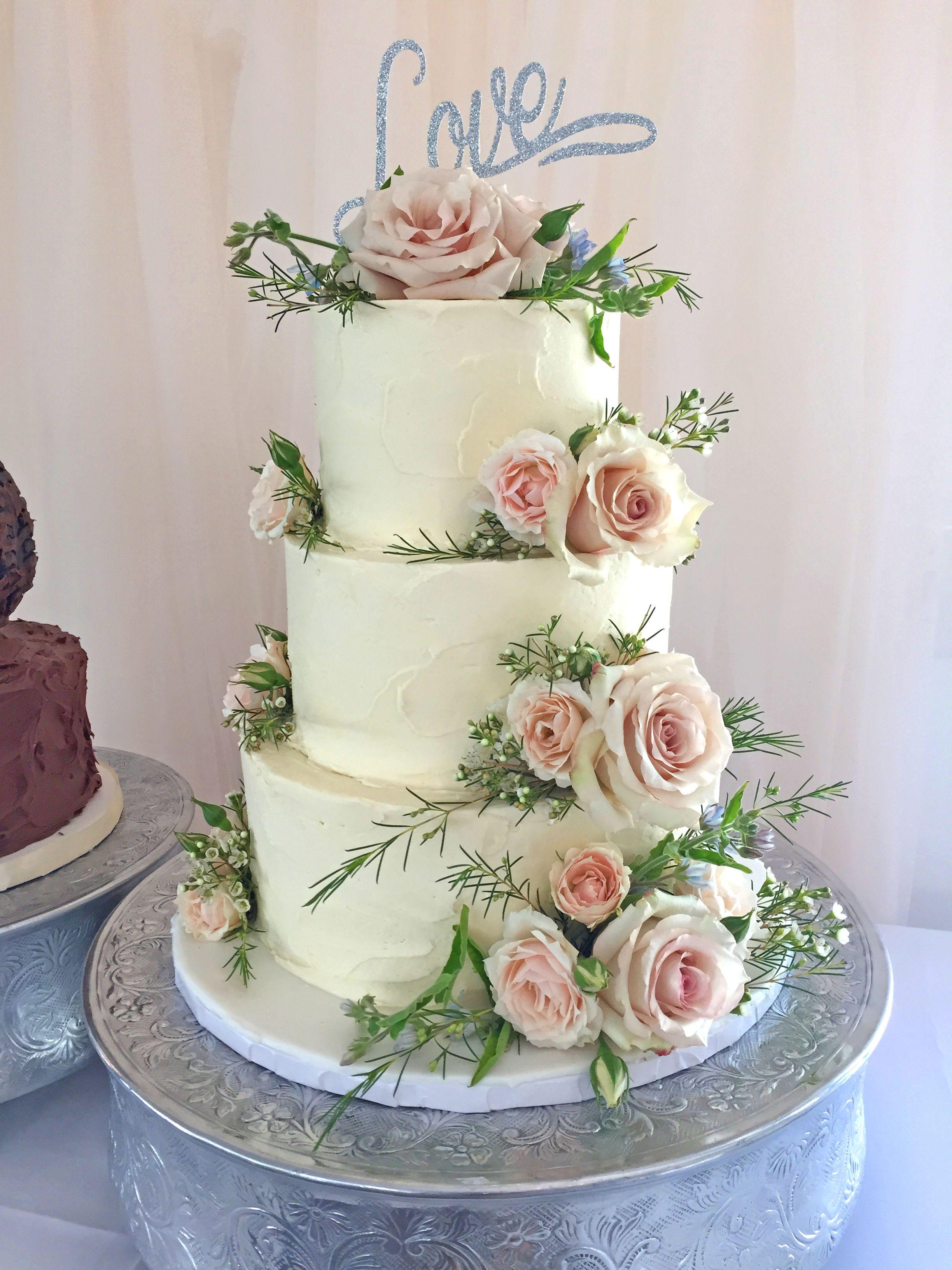 Buttercream wedding cake with light pink roses | Wedding ...