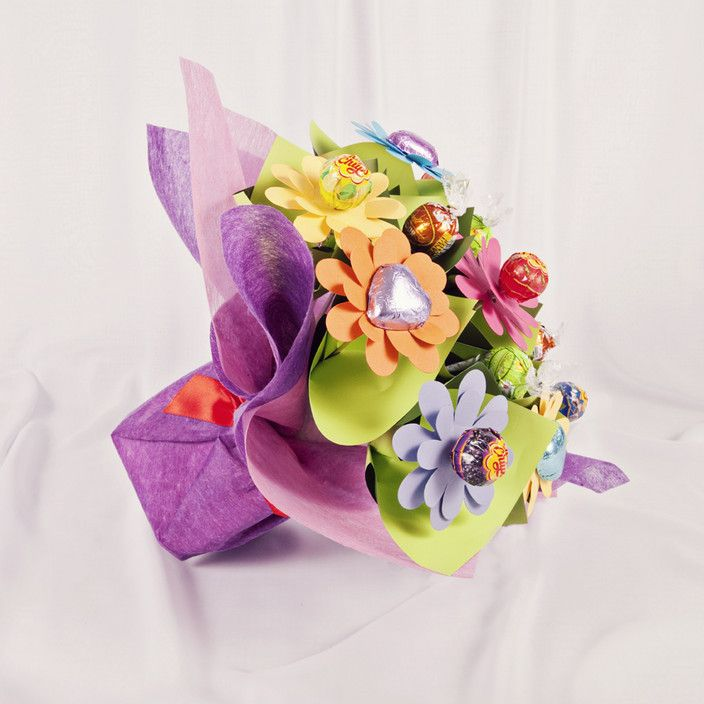 A fun and funky bouquet of lollipops and Chocolate flowers. FROM ...