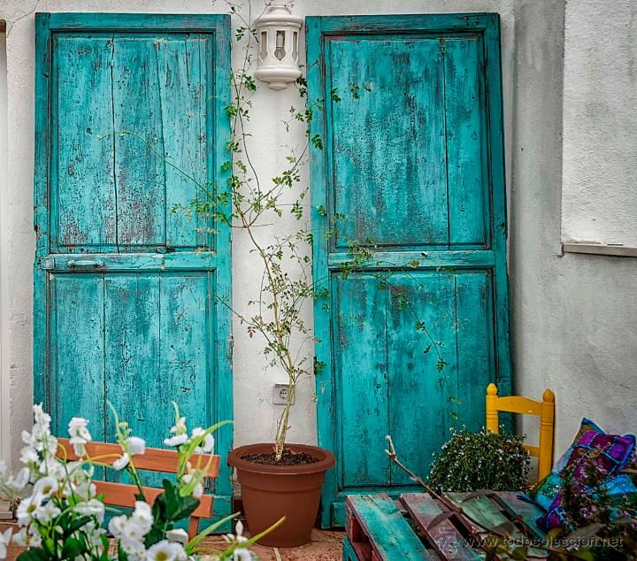Antiguas y decorativas puertas de madera del centro for Imagenes de puertas viejas
