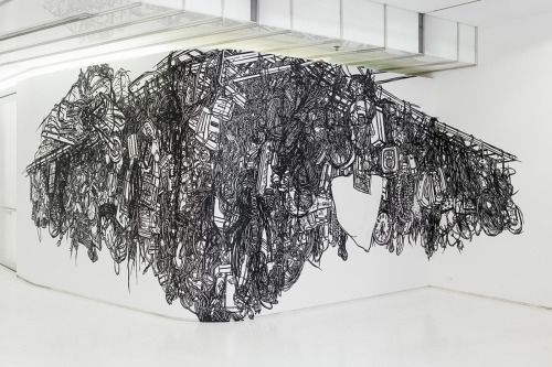Heeseop Yoon uses black tape to create her enlarged wall drawings, working additively such that her mistakes and miscalculations are visible in the final installation. She's interested in this paradox: the more she corrects her work, the less legible the drawing becomes.