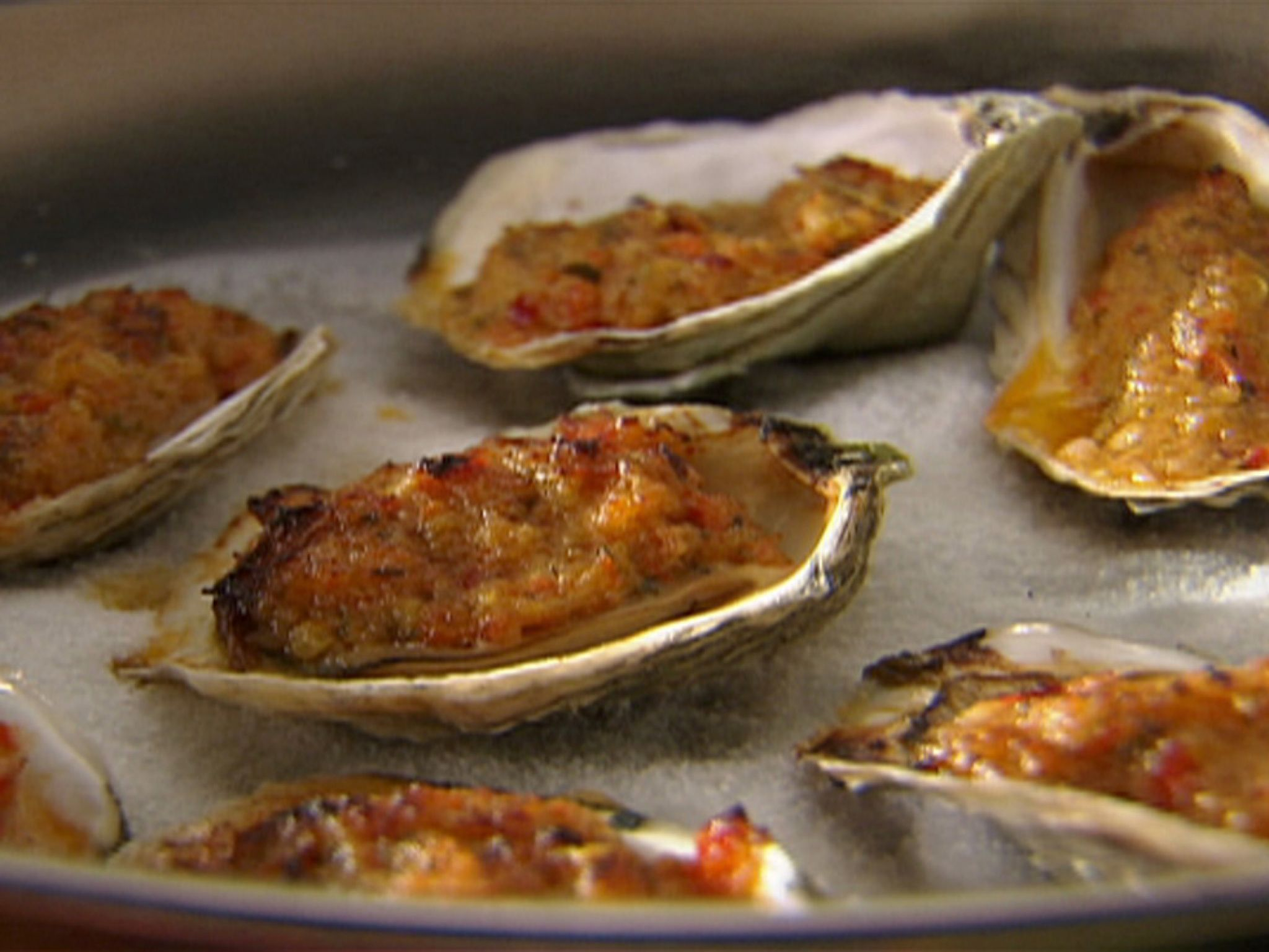 Oysters Casino with Red Bell Peppers, Chili and Bacon recipe from Tyler Florence via Food Network