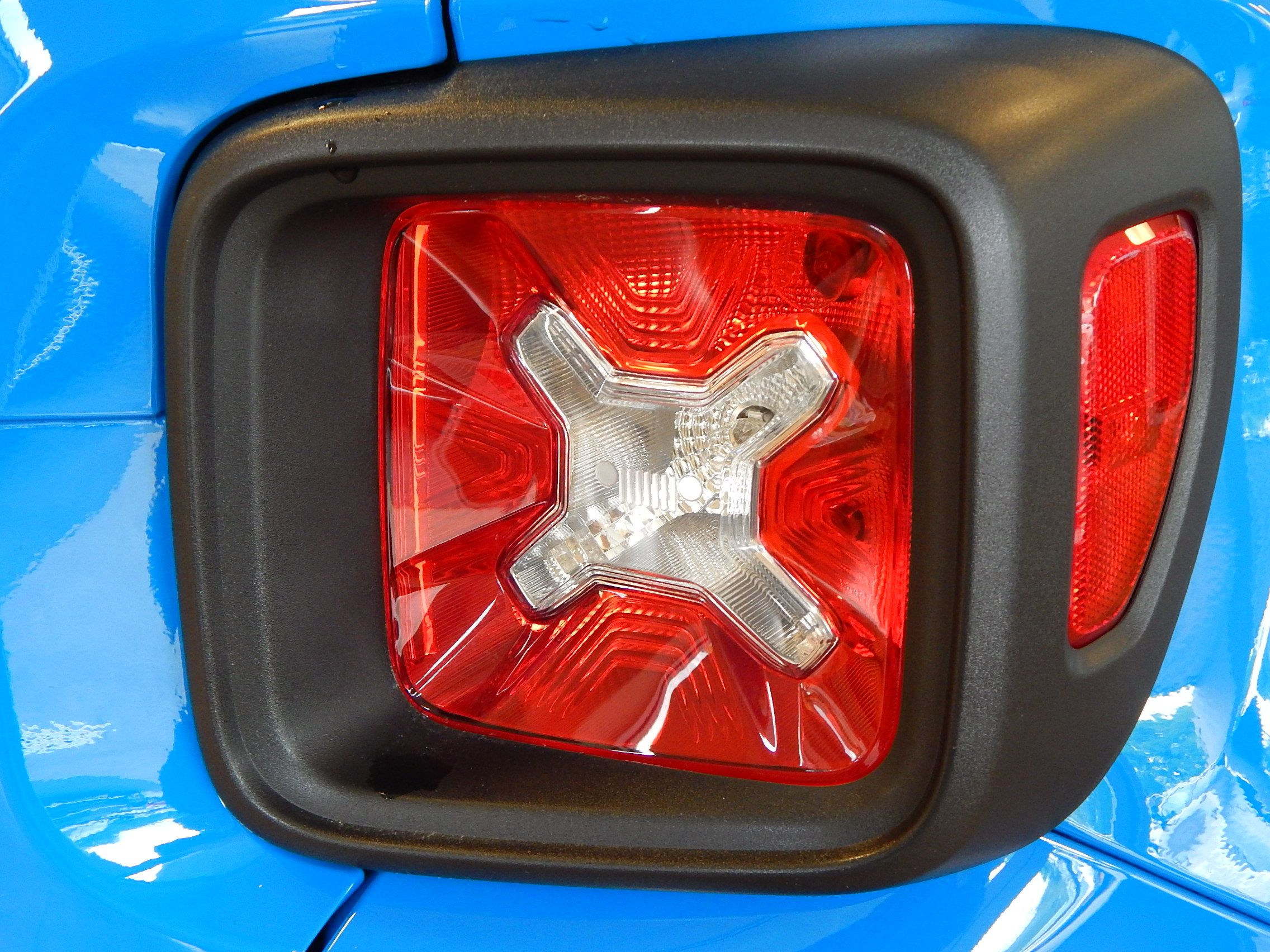 Cool tail light of the 2015 Jeep Renegade Latitude. The ...