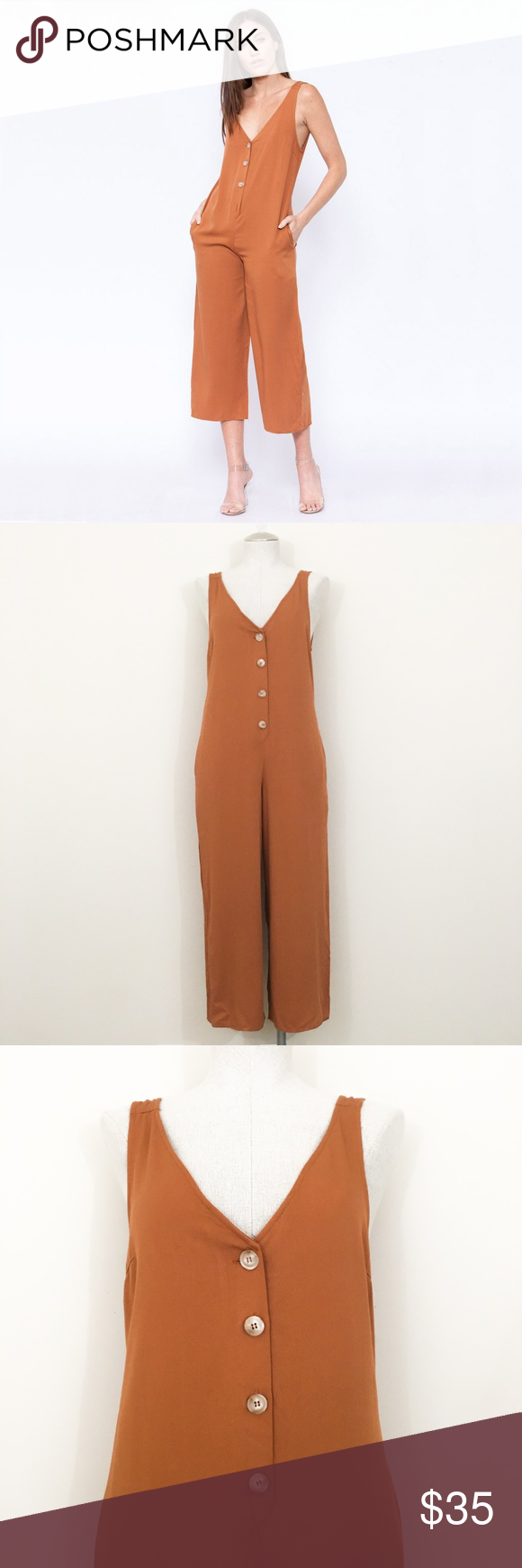 77c0d326bbf3 Sadie   Sage Jeanette Jumpsuit Sadie   Sage Jeanette Jumpsuit Mustard  Yellow   Orange This jumpsuit falls below the knee and features a button  down placket.