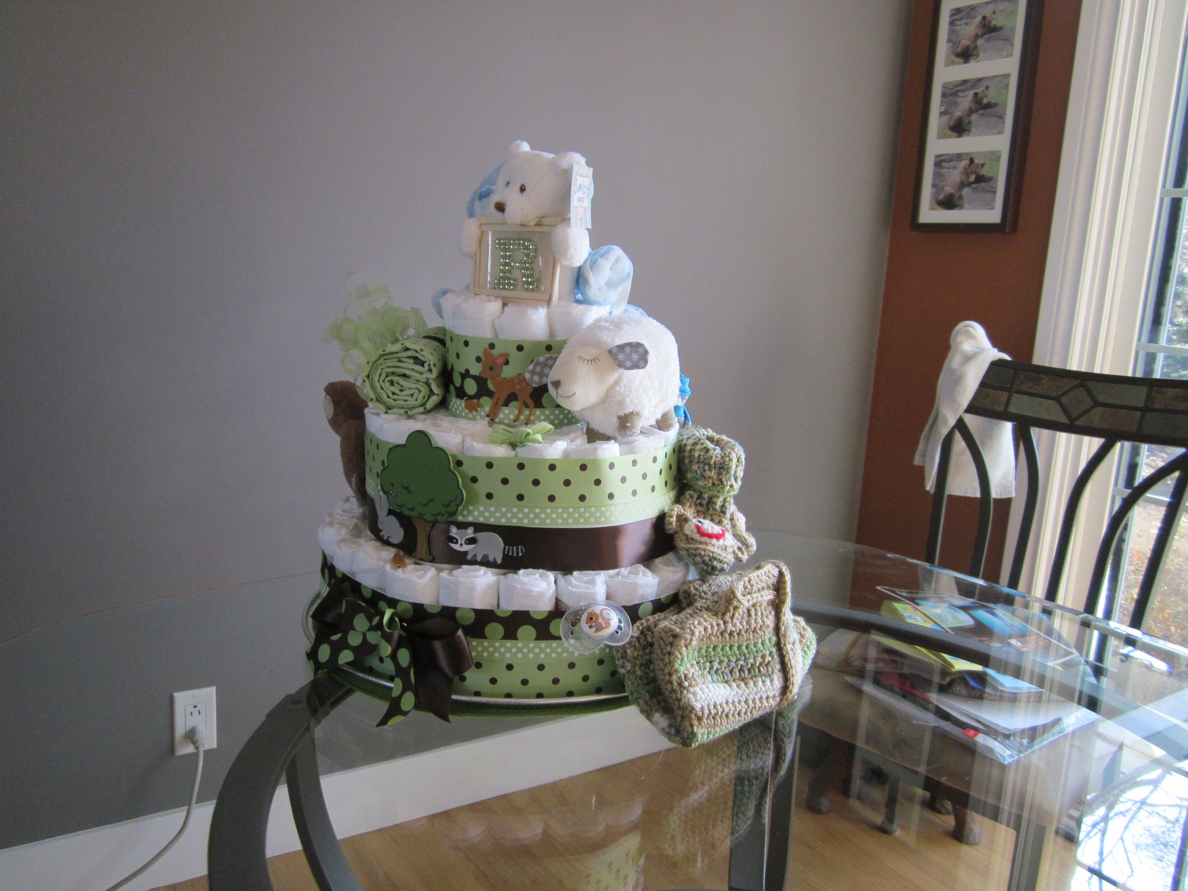 Diaper cake with a woodland animal theme.  Stickers, scrapbook, diapers, sweater and booties and snugglie teddies - all for my great nephew.  This was tons of fun.