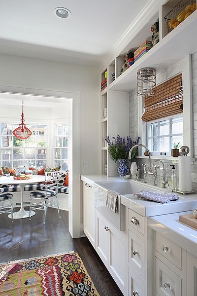 love the breakfast nook the table maybe no wall between nook and kitchen love all the glass the blind over the sink window and the pop of colors in the