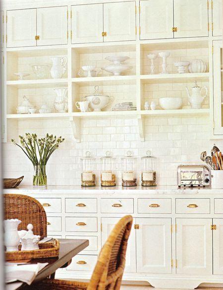 farmhouse kitchen.  white + open shelving + apothecary jars + brass hardware.