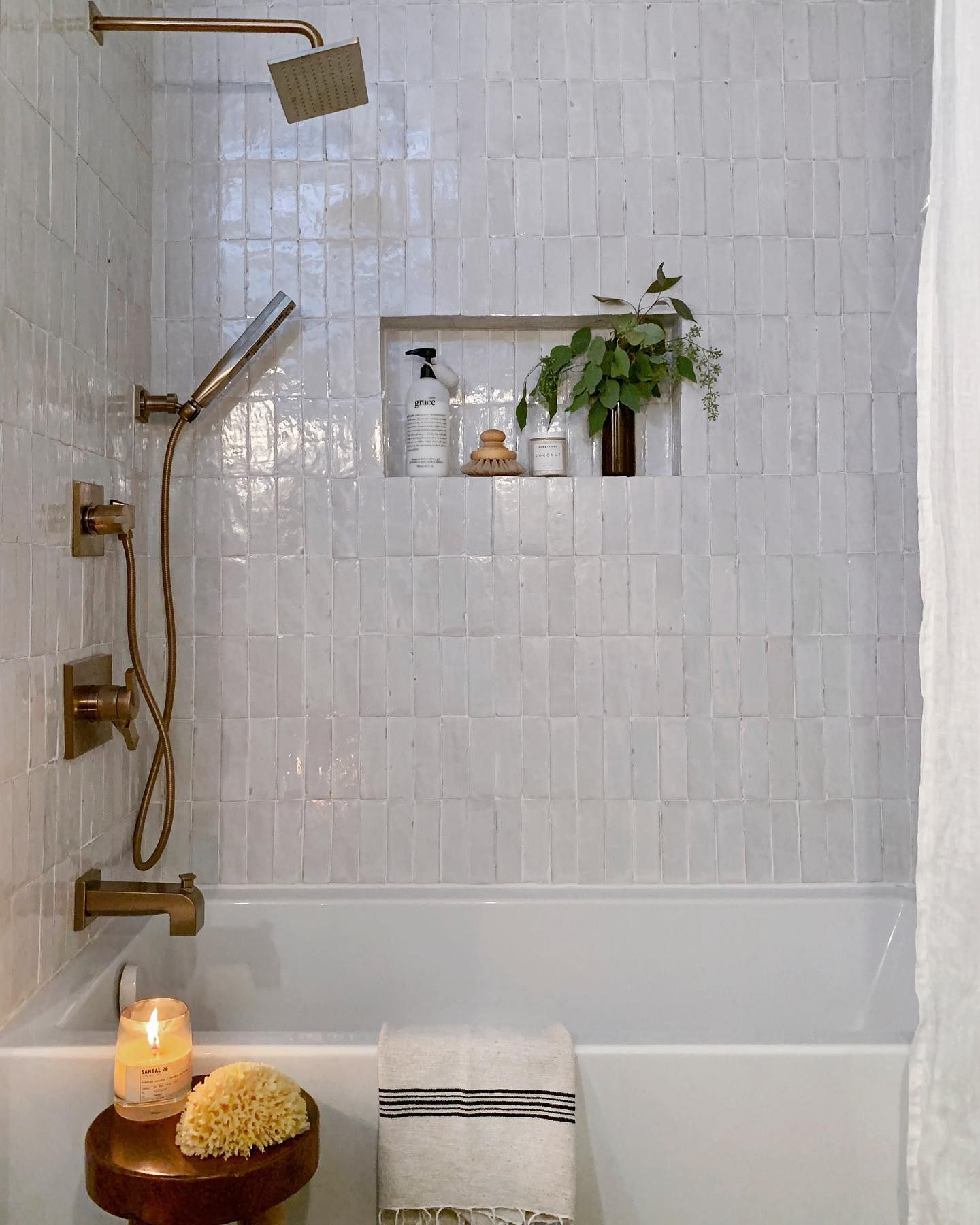 Our beautiful 2x6 Snow Zellige tile and brass fixtures ...