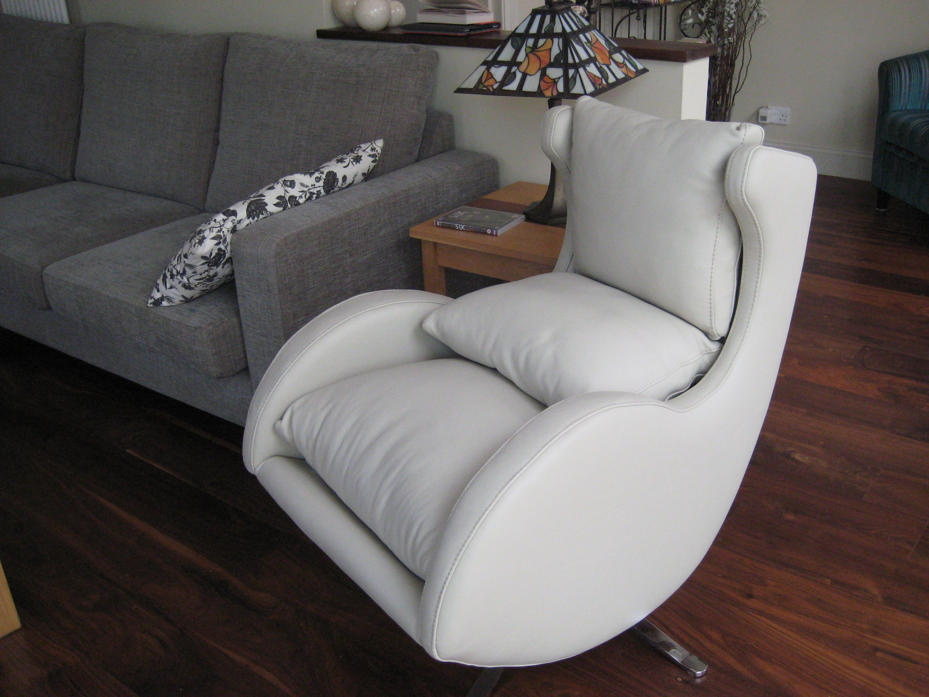 White leather on our popular compact designer swivel chair