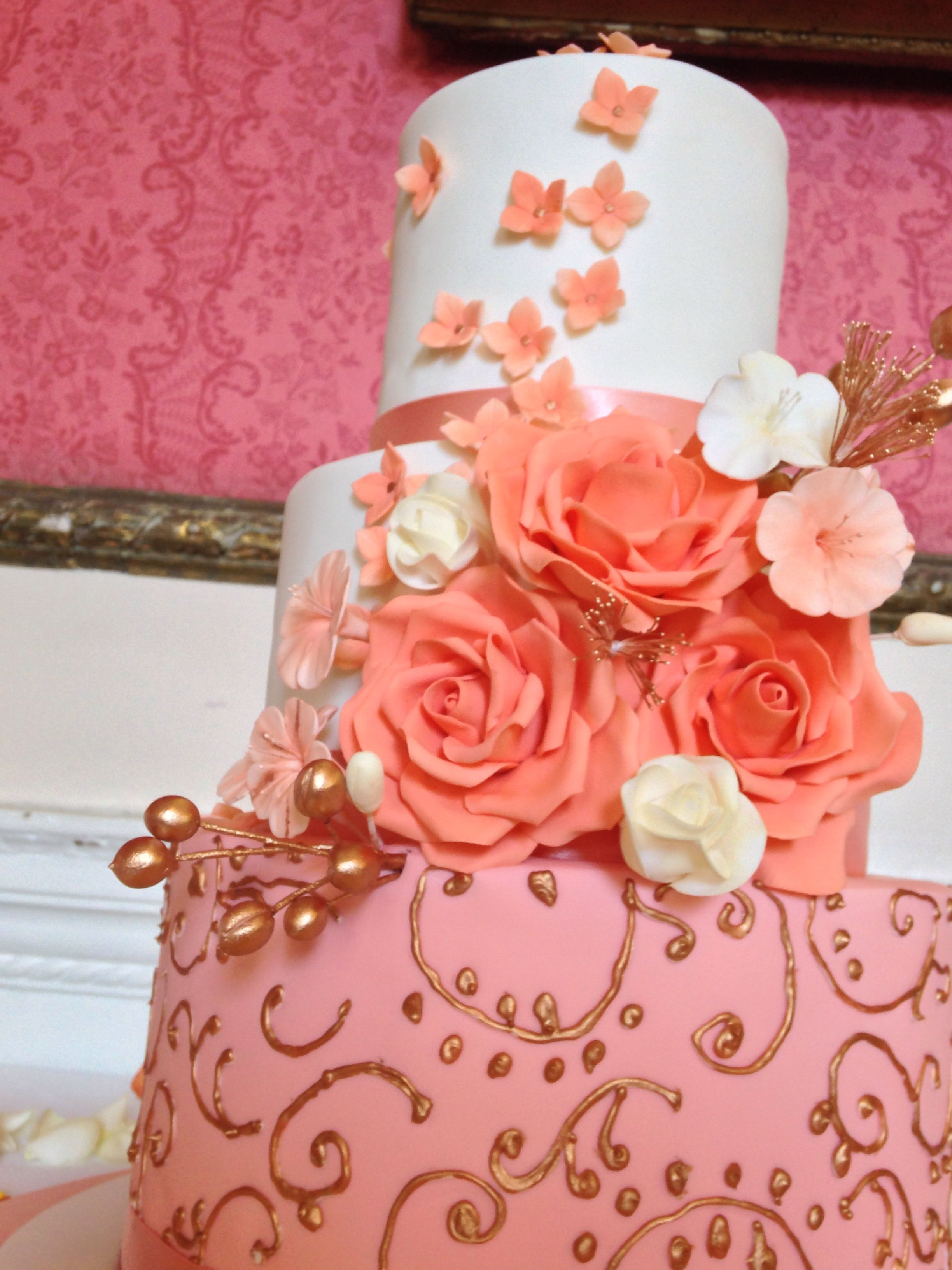 Three tiered peach and ivory wedding cake. #peach #coral ...