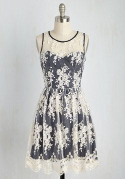 Girls and Poise Dress. Embrace your romantic composure by flaunting this lacy A-line dress.This ivory floral frock is brimming with elegant details, from its illusion neckline and diamond-patterned cutouts on its back to the sweetheart bodice and matching piping of its navy contrast underlay. #blue #modcloth