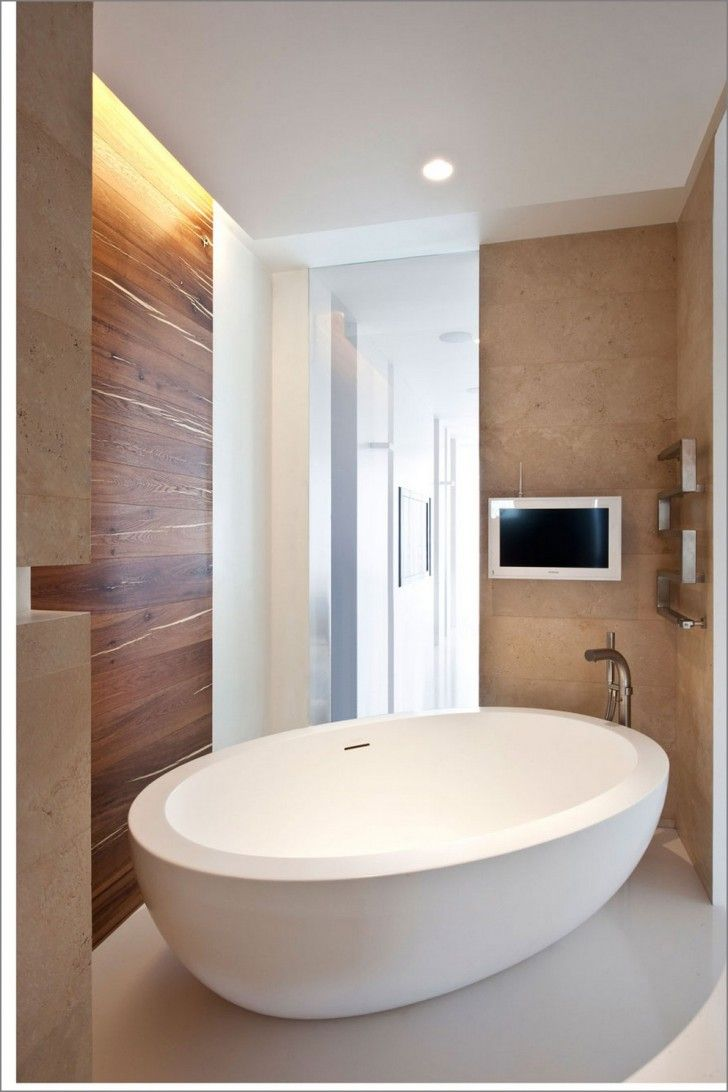 cream wall tile with oval stand alone bathtub on white