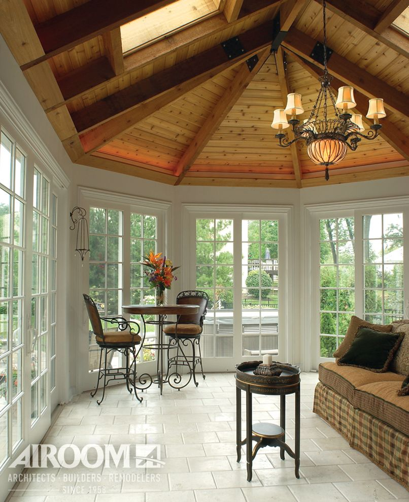 Landscape Lighting Northbrook: A Volume Ceiling With Unfinished Wooden Beams Contrasts A