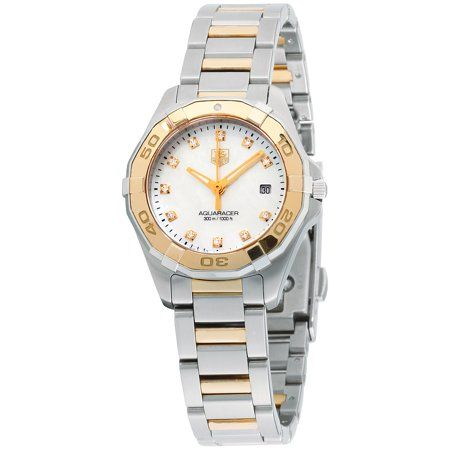 Tag Heuer Aquaracer Mother of Pearl Dial Stainless Steel Ladies Watch WAY1451.BD0922. 27 mm stainless steel case with a gold tone minutes scale bezel. A white mother of pearl dial and a scratch resistant sapphire crystal. Gold tone luminescent hands and diamond hour markers. Minute markers around the outer rim. Date at 3 o'clock. Hands: hours, minutes, and seconds. Case thickness of 10 mm. Screw down crown. 16 mm silver and gold tone stainless steel bracelet with a deployment clasp. Automatic mo
