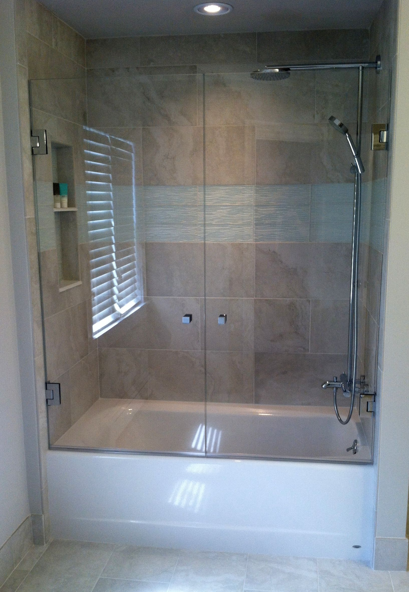 French Shower Doors Mount A Swing Door On Each Wall To Open Up Your Bathtub Space Bathtub Shower Doors Tub Shower Doors Tub With Glass Door