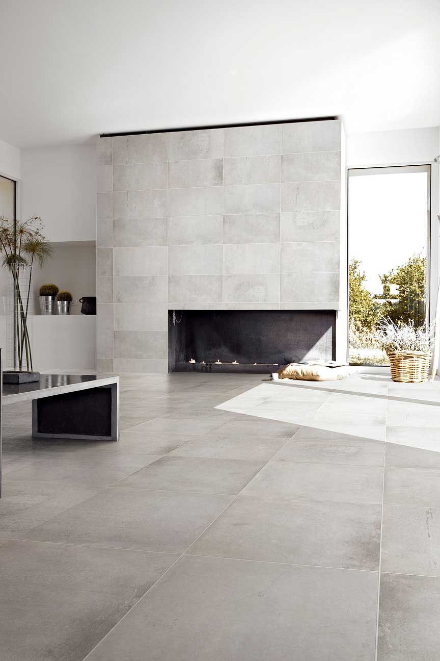 Minimalist Living Area With Gray Ceramic Floor Tiles And Modern Fireplace Nonagon Style Floor Tile Design Tile Floor Living Room Living Room Tiles Living room tile flooring