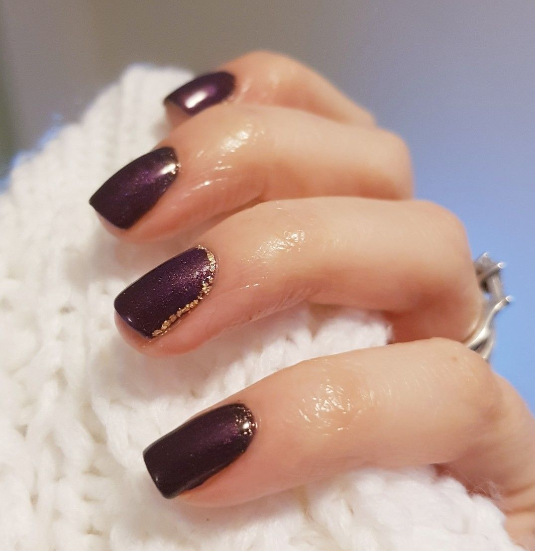Dark purple nails with gold leaf design around the cuticle and side ...