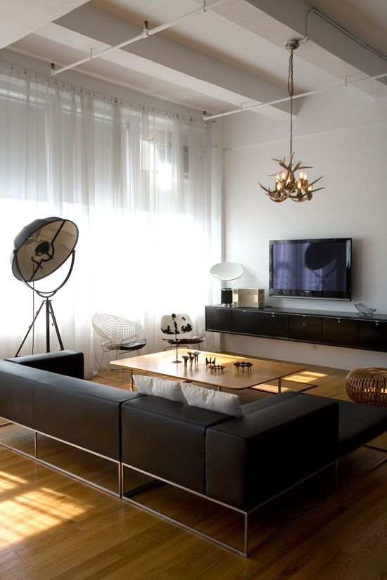 Love the sheer curtains, Le Fortuny lamp, and black lounge