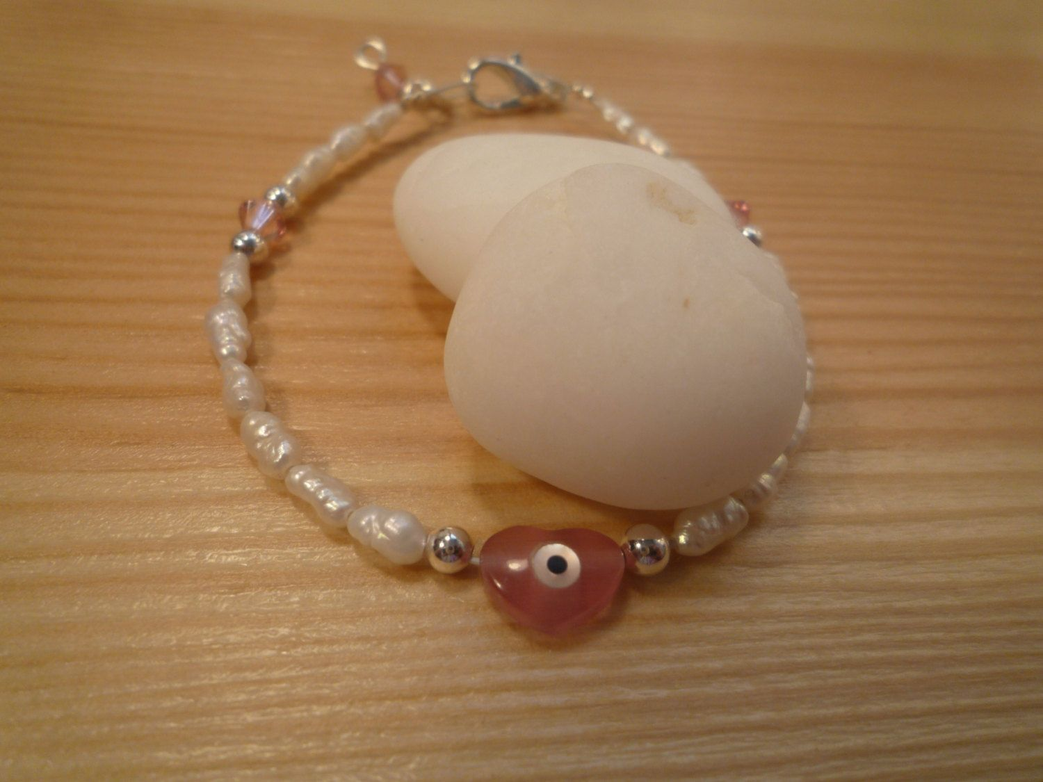 Handmade Kids' Ivory Freshwater Pearls Bracelet with Swarovski Crystal Elements and Mother of Pearls Evil Eye Protection Heart by urbaneprincess on Etsy