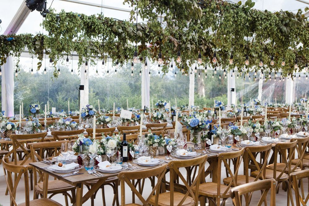 Botanical Marquee Reception With Hanging Greenery Edison Light Installations Caroline Castigliano Bridal Gown