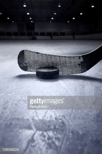 A Dramatic Close Up Of A Hockey Stick And Puck From A Surface Level Hockey Stick Hockey Posters Hockey Pictures