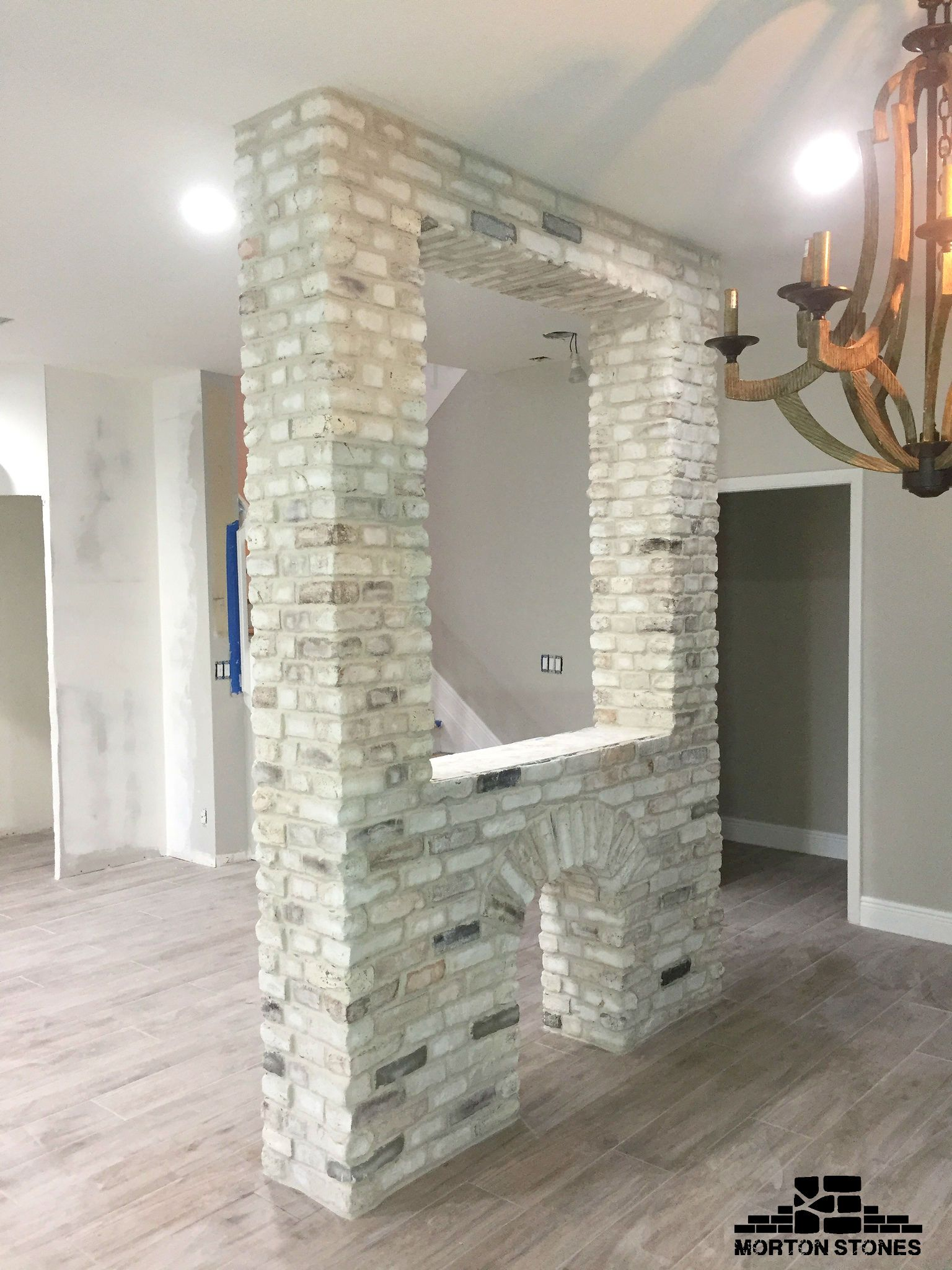 A whitewashed brick parion wall in a home. #mortonstones ... on