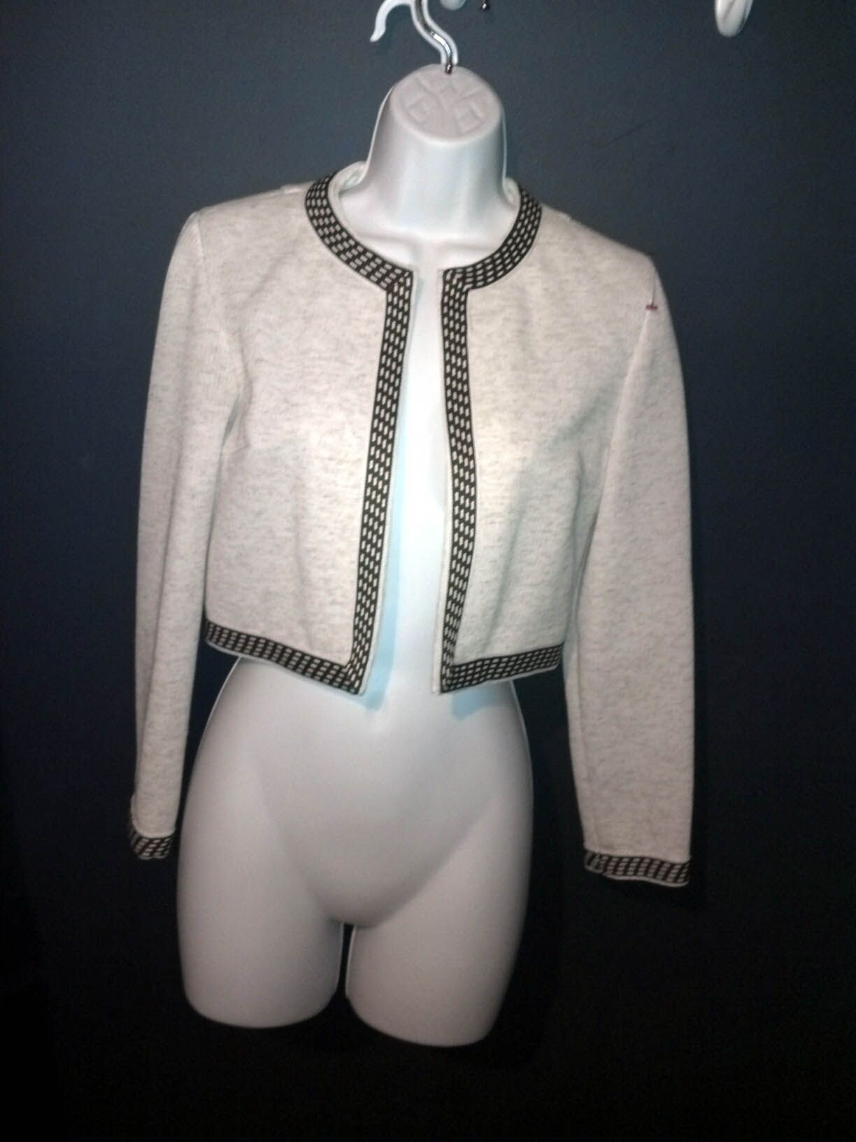 great boxy chanel-esque jacket. you can't tell from the picture but it is a super tiny fit.