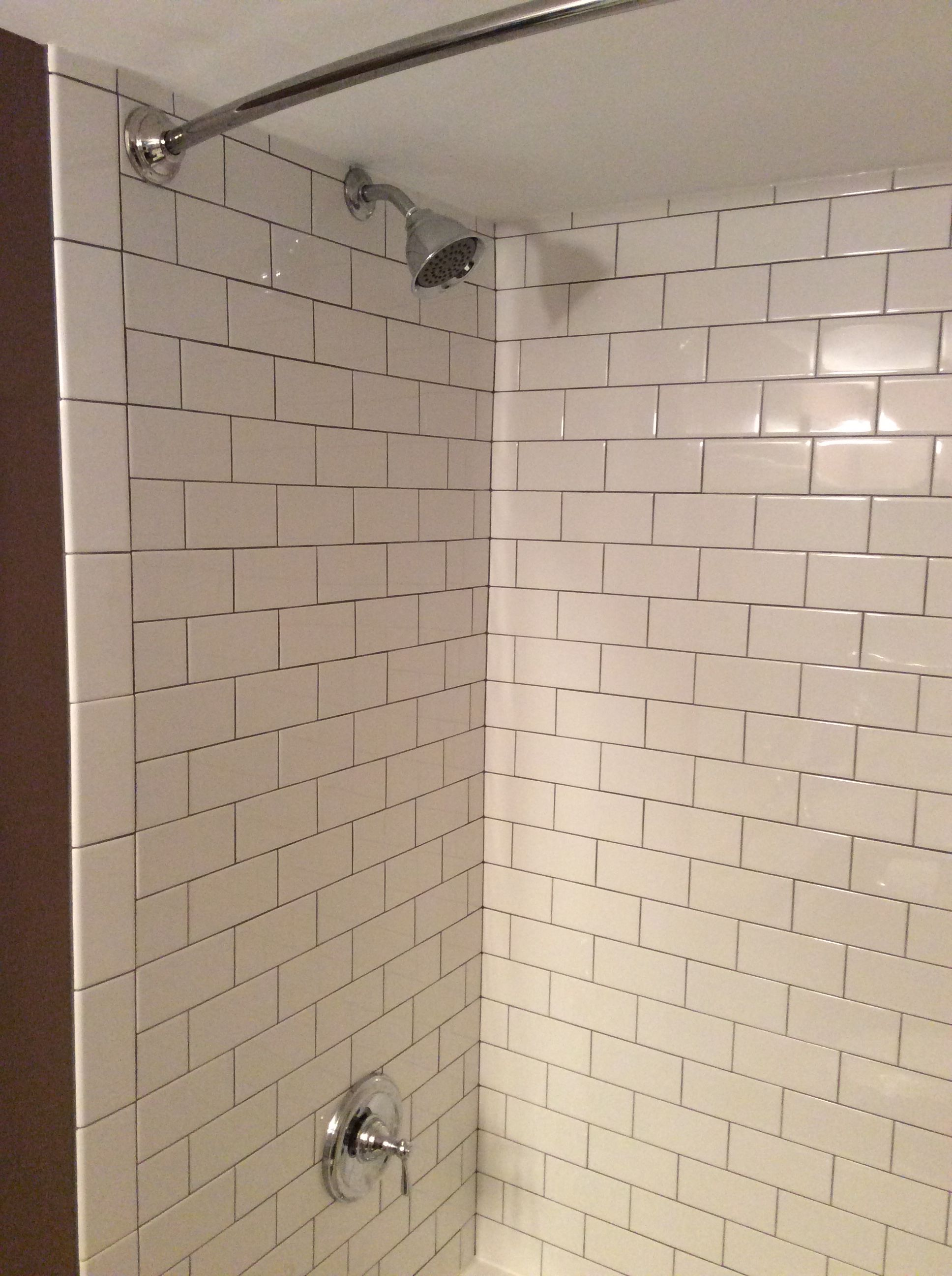 White Subway tile on shower wall with picture framed niche
