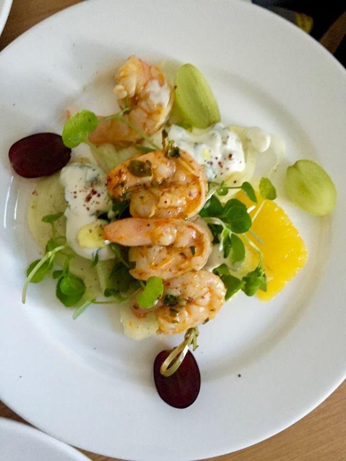 Harissa Prawns Served With Tzatzikifennel Grape Walnut Salad