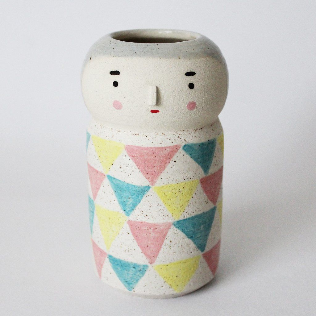 Uroko lovesKabuki and kimonos: Thispot is from our Kokeshiseries. The shape of the pot is inspired by Japanese Kokeshi Dolls.by Polkaros