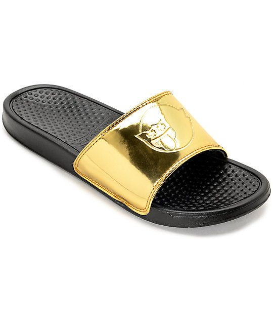 16c528e252a7 The Pink Dolphin Ghost Gold and Black Slide Sandals are stylish featured  with an embossed ghost