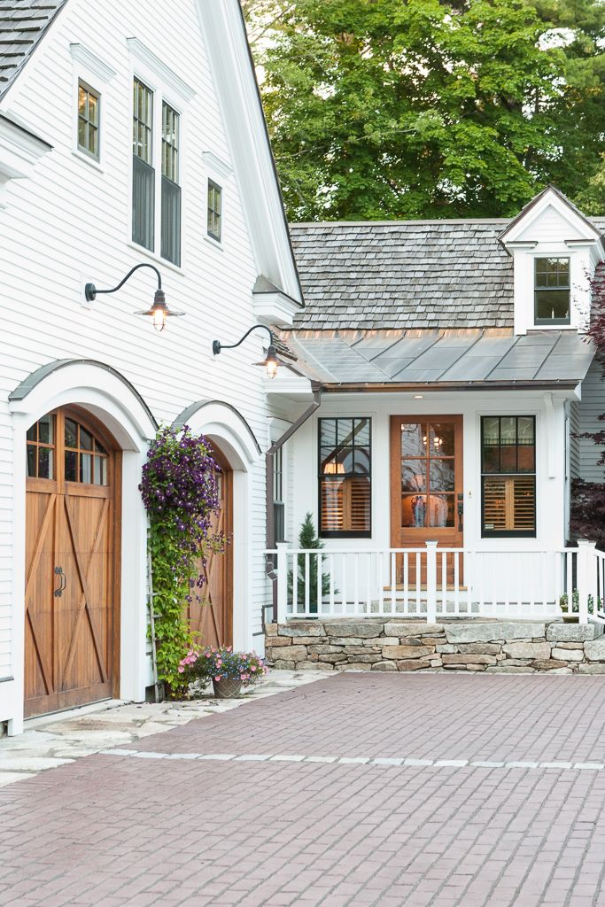 LOVE These Wood Arched Garage Doors On This White Modern Farmhouse Inspired Home Exterior