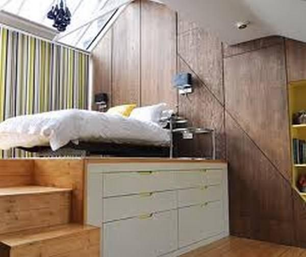 Given that a bed always takes up a significant amount of floor space in a room, putting in an elevated sleeping platform with built in storage, seems like a great way to maximise space in a small room to me.    What do you think of this?