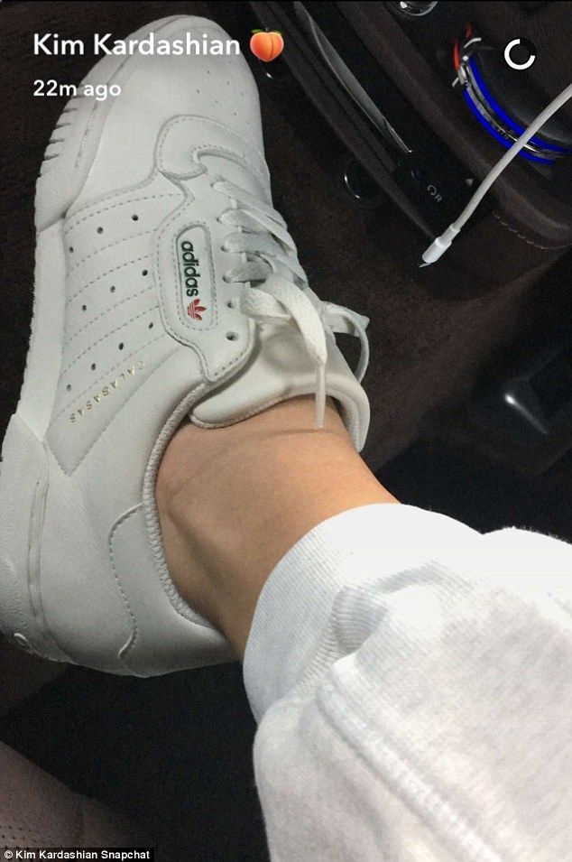 Loyalty  Kim Kardashian showed off new Adidas Calabasas sneakers on  Snapchat Tuesday - which were in fact designed by her husband Kanye West 5f209e26b