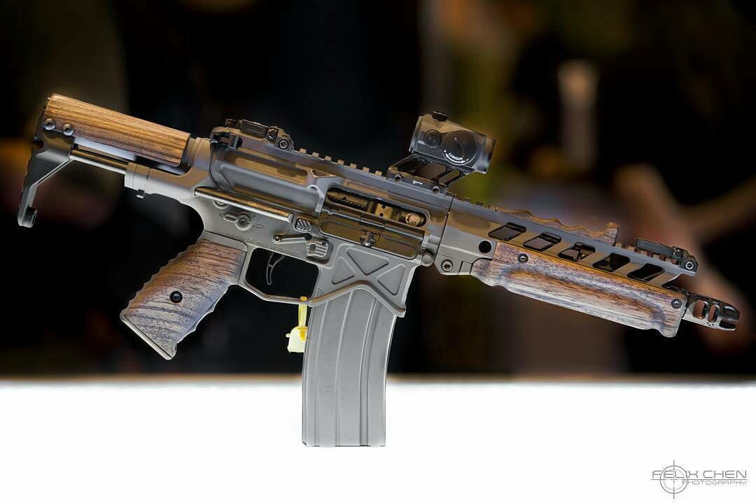 BAD PDW SBR, this gun is small compacted built on an ar15 rifle platform, tactical, wooden grips and fore end, brown and black