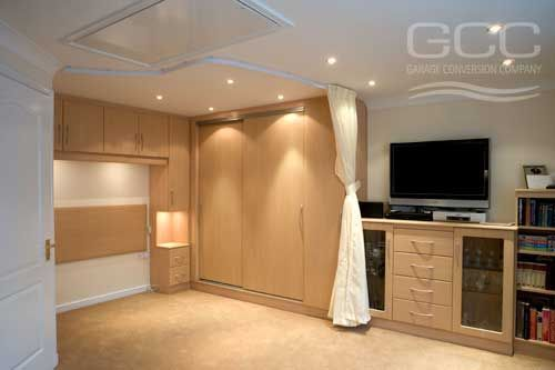 Turn Garage Into Apartment garage to bedroom conversion. love the built in around where the