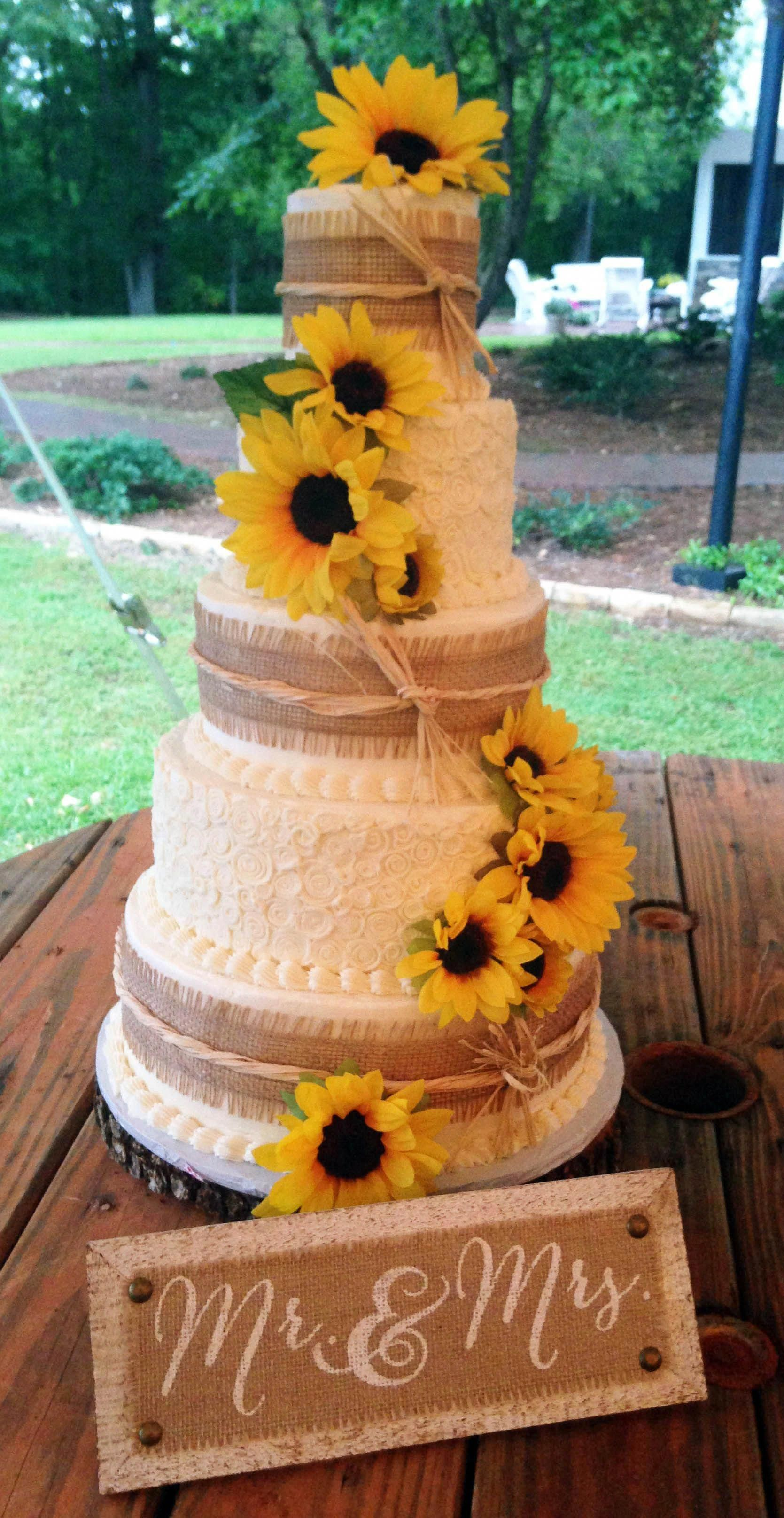 Rustic country wedding cake adorned with golden sunflowers ...