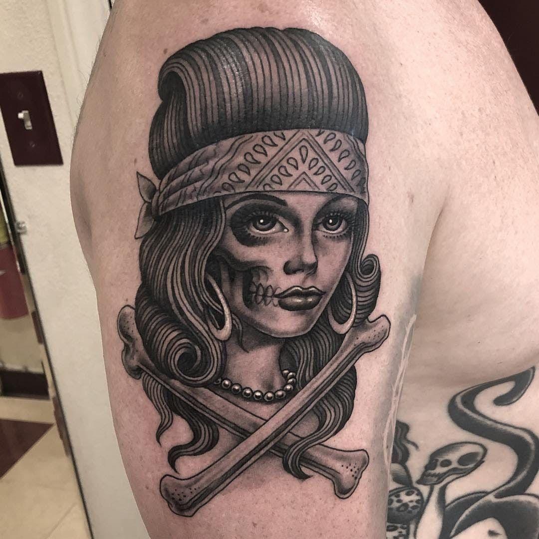 Tattoo uploaded by Tattoodo   Tattoo by Tim Hendricks #TimHendricks #portraittattoos #portraittattoo #portrait #face #Chicano #blackandgrey #illustrative #bandana #lady #ladyhead #babe #pearls #crossbones #death #skull   772440   Tattoodo