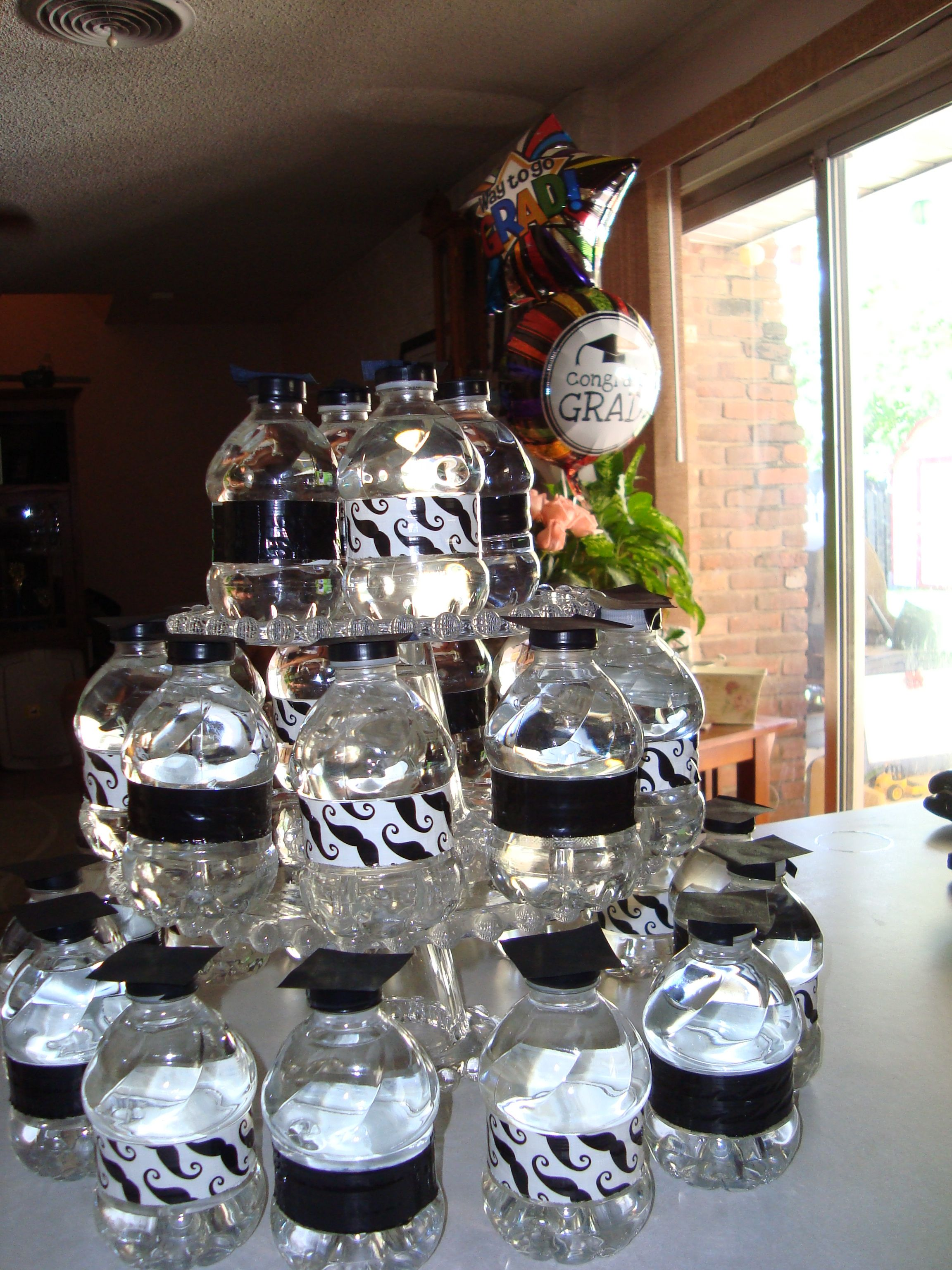 small water bottles with duct tape & paper hats for Amy's graduation party