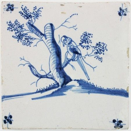 Antique Dutch Delft tile in blue with a parrot in a three, 17th century