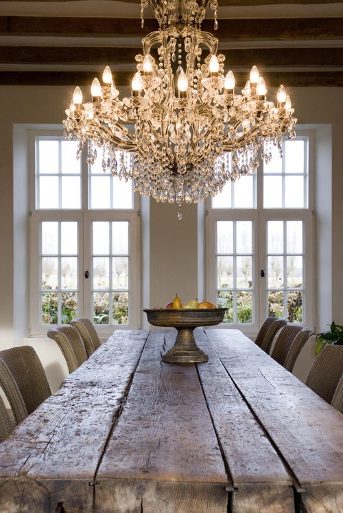 Farmhouse Dining Room Table And A Dramatic Elegant Chandelier Over It In Love