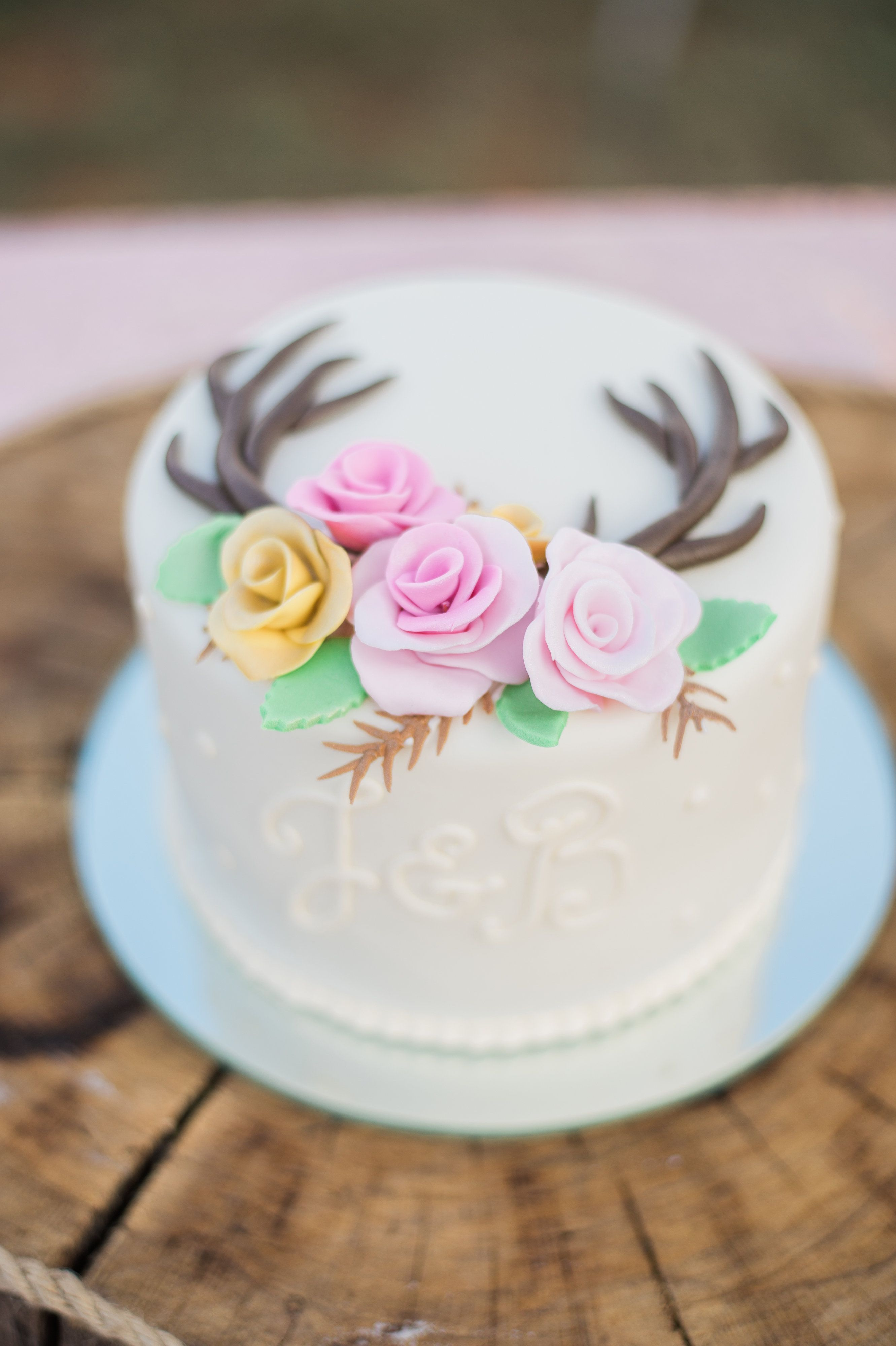 Antler cake with roses wedding cakes pinterest antlers