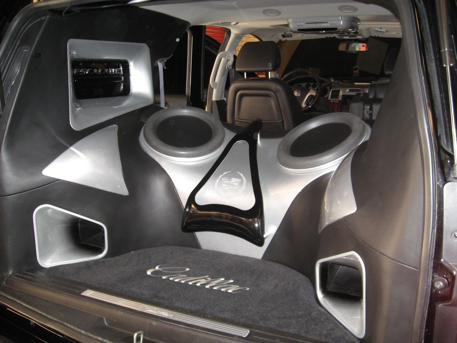 Trunk Car Audio Escalade Jl Audio Full Build Out In The Rear 13w7s 1000 1 Amps Car Audio Car Audio Subwoofers Car Audio Installation