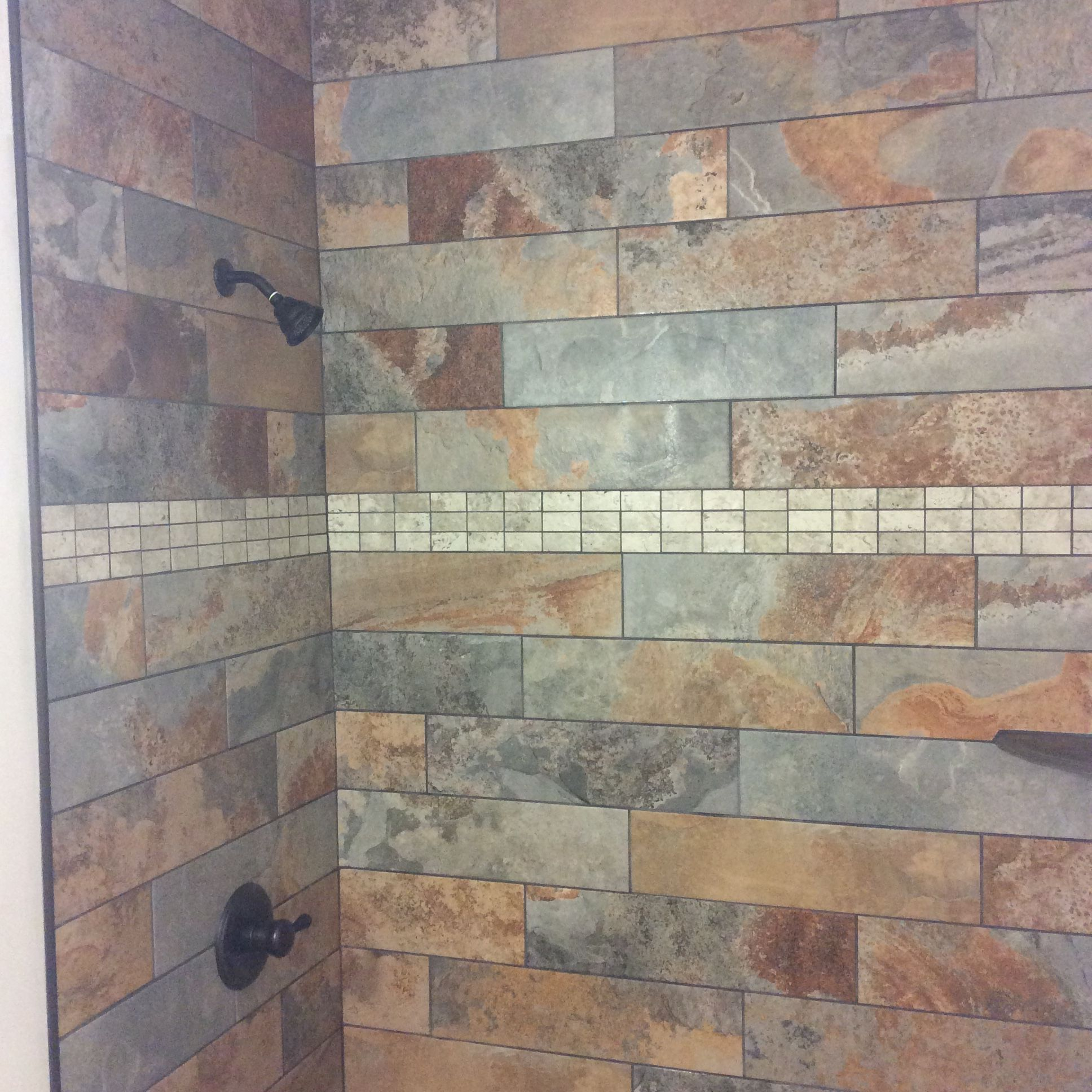 We installed slate tiles with mosaic shower base and weathered wood we installed slate tiles with mosaic shower base and weathered wood look ceramic tile floor dailygadgetfo Gallery