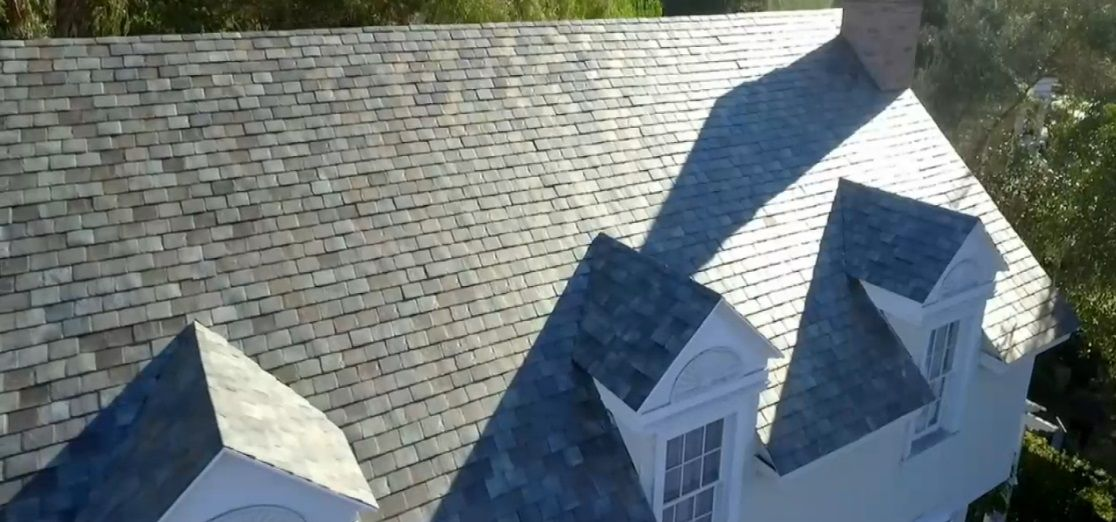 http://insideevs.com/wp-content/uploads/2016/10/tesla-solar-roof-french-slate-roof.jpg