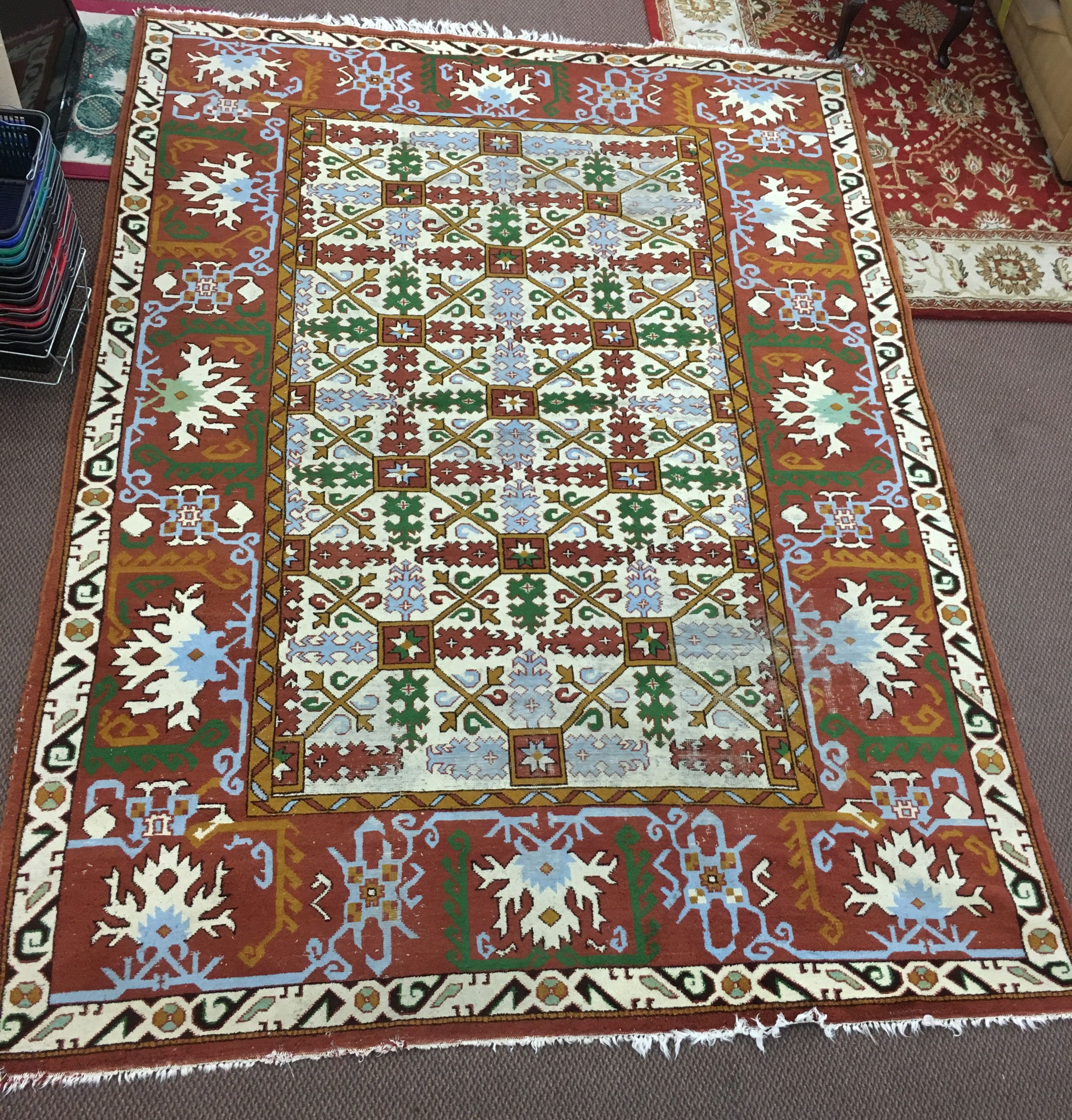 This rug us beautiful! It was handwoven in Turkey and measures 8'x11'. It has been professionally appraised for $2,000. Our price: $499.99.
