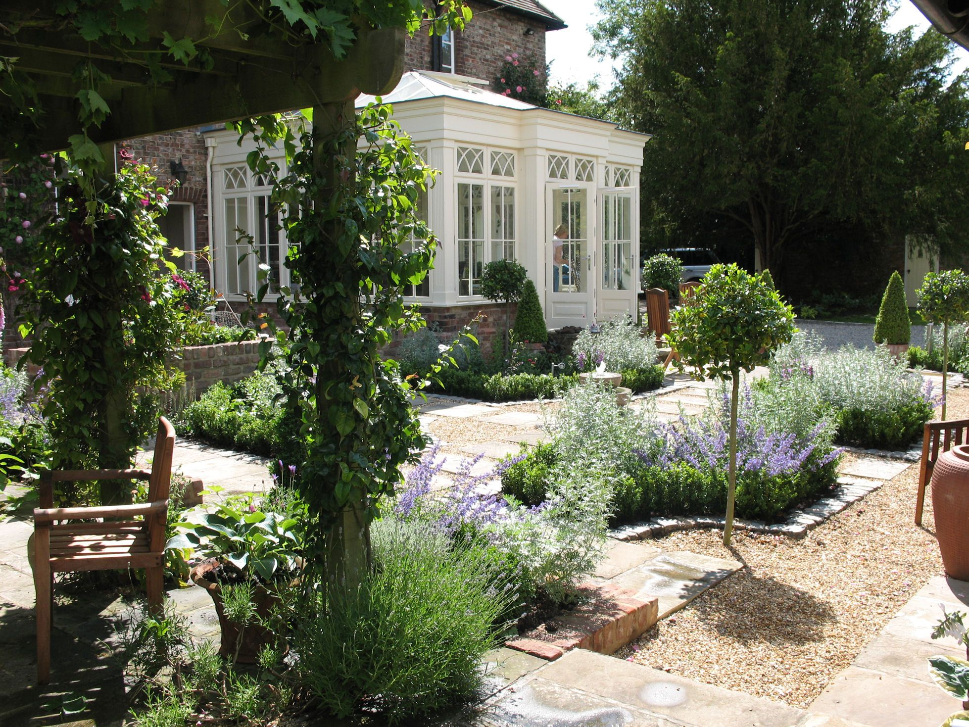 A formal courtyard garden near York. Designer Garden in