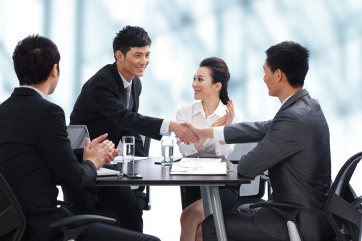Businesspeople Shaking Hands At Meeting Stock Photos Photo Meeting