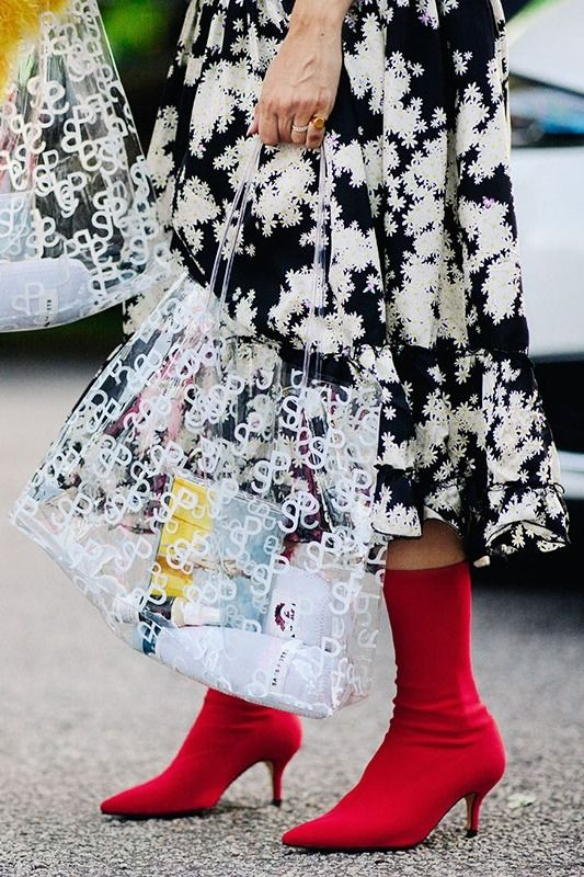 39d340c4fca4c Copenhagen Fashion Week Street Style: red ankle boots, floral dress, and a  clear shopper bag