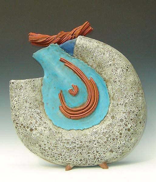 """""""Terrestrial Orb"""" - Nelfa Tompkins (Stoneware clay. Hand built and hand carved accented with velvet underglaze, applied with slip glaze, volcanic and turquoise glazes.)"""