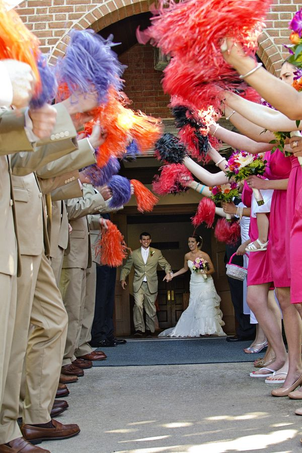 Colorful Pom Exit From A Hot Pink Beach Themed Ocean City MD Wedding